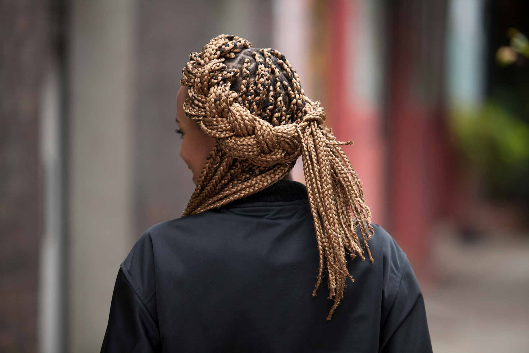 back view of crown box braids style on blonde box braid extensions