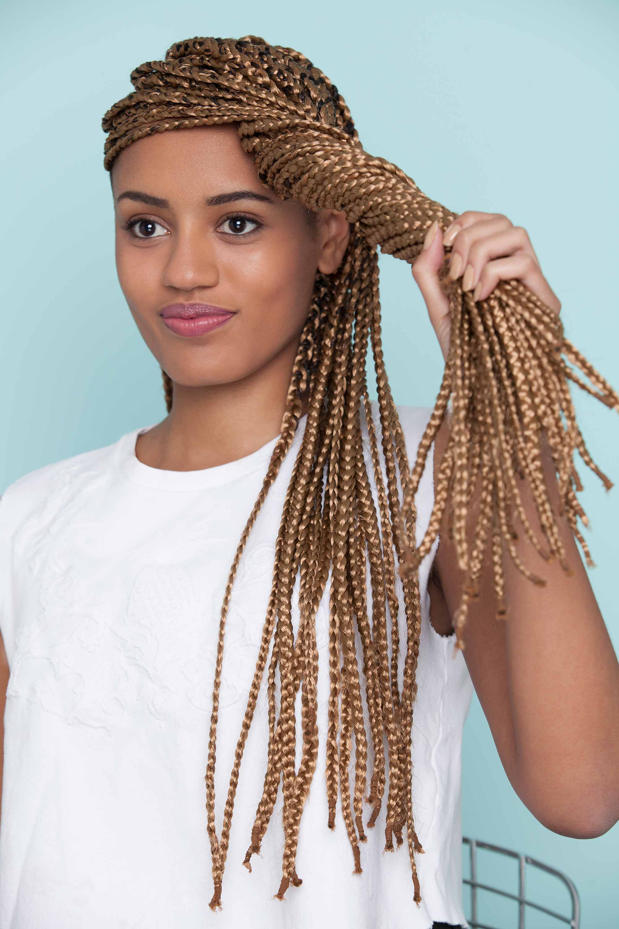 styles with box braids twisted into a bun