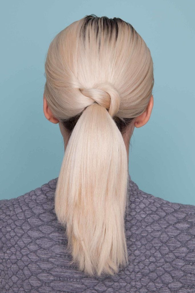a picture of knotted thick hair ponytail for a woman