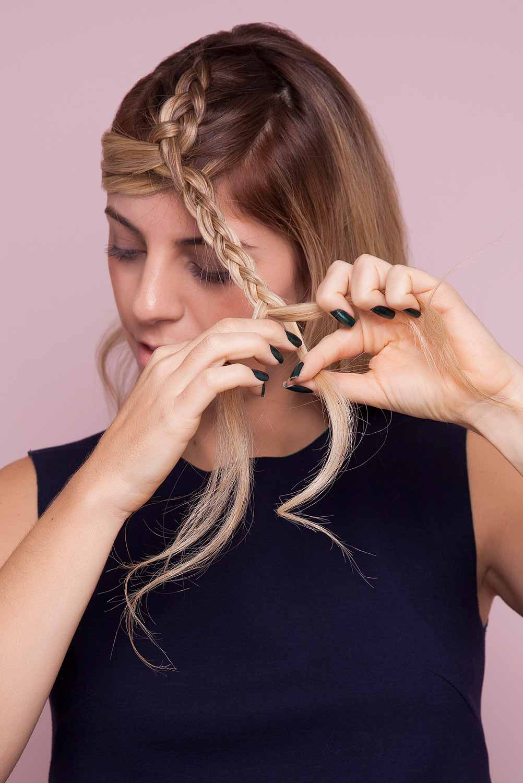 blonde woman creates split crown braid and separates braid