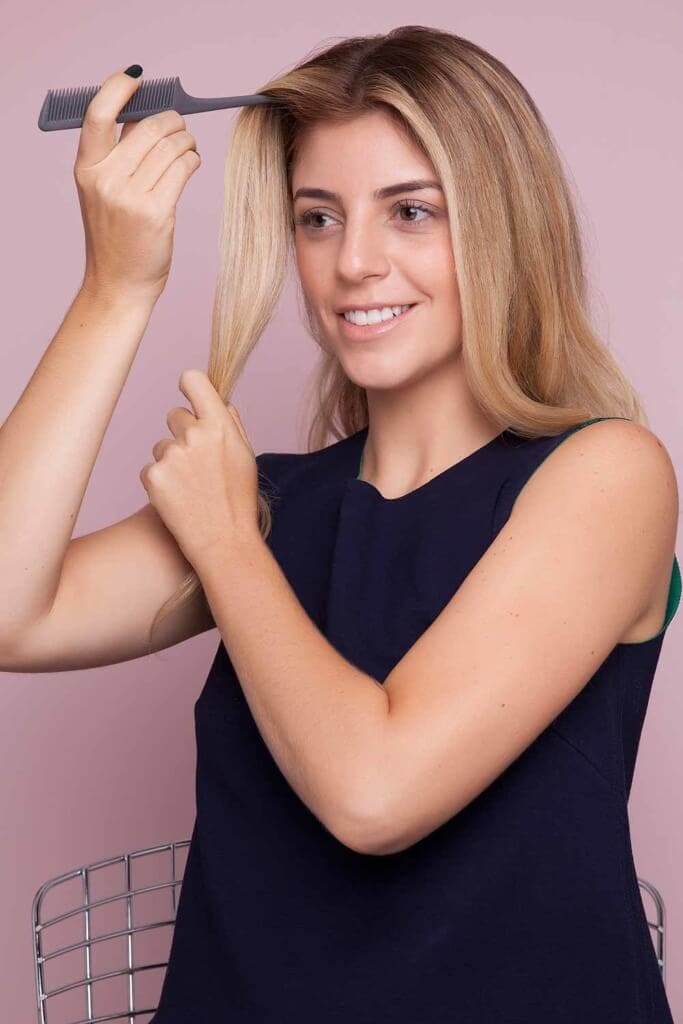 blonde woman creates split crown braid and sections hair