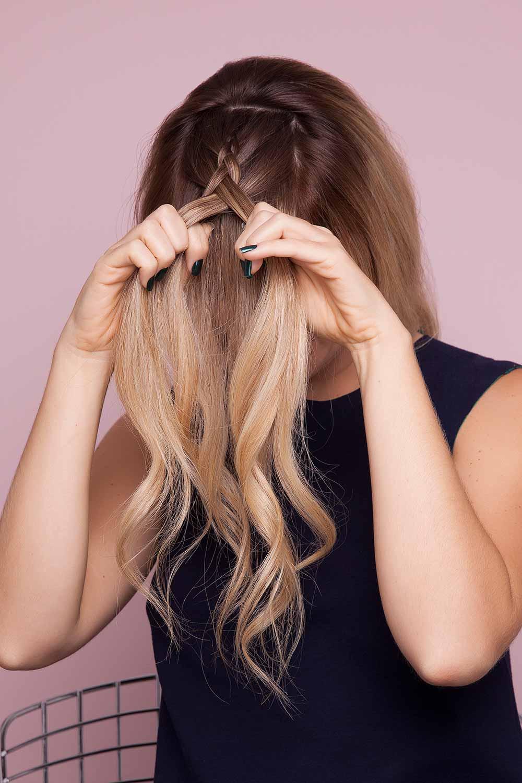 blonde woman creates split crown braid and braids hair