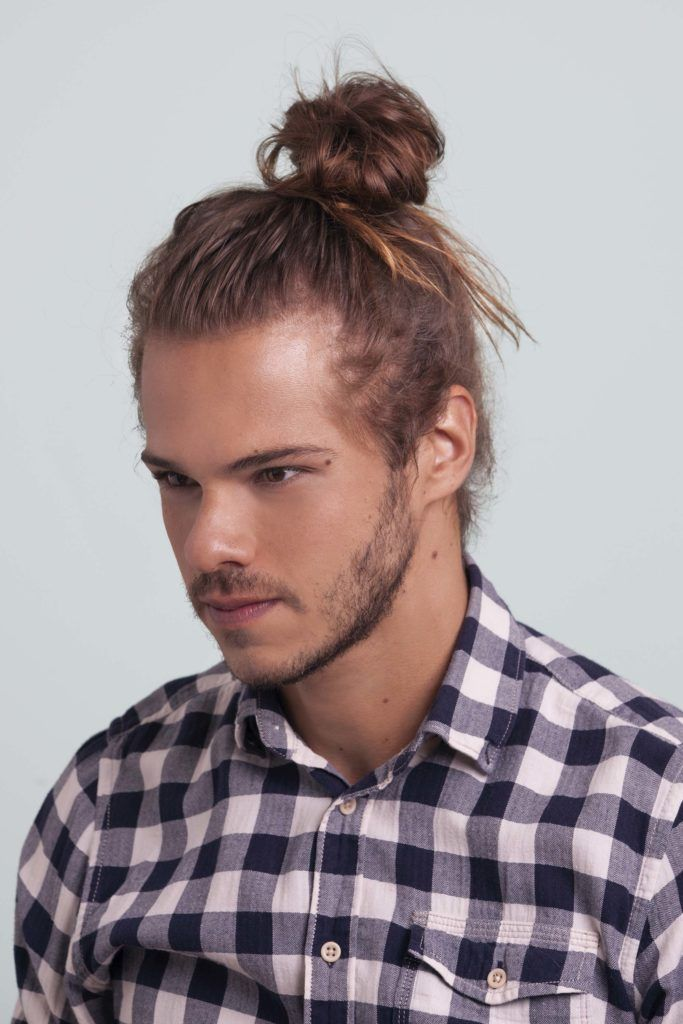 blonde man shows how to make a man bun and leaves ends messy