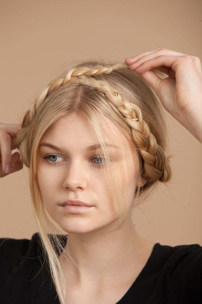 twist the second braid across your crown to create your milkmaid braids