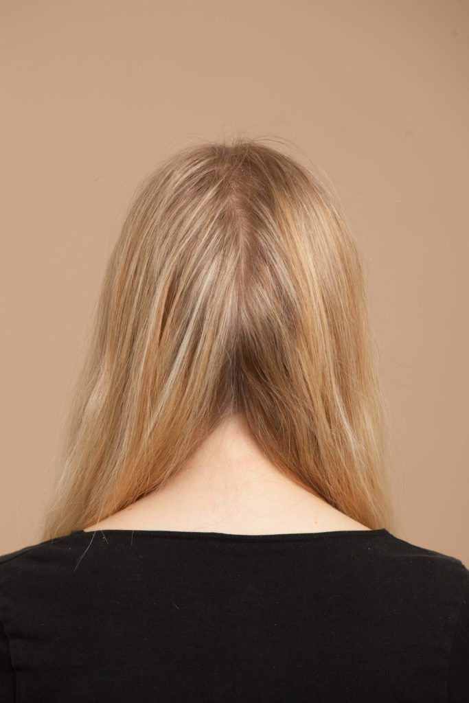 separating your hair is the second step in creating milkmaid braids