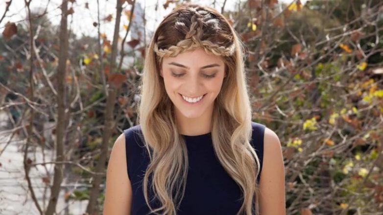 blonde woman wears split crown braid outside