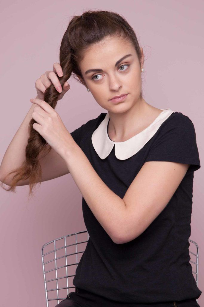 twist your ponytail and create the structure of your undone bun