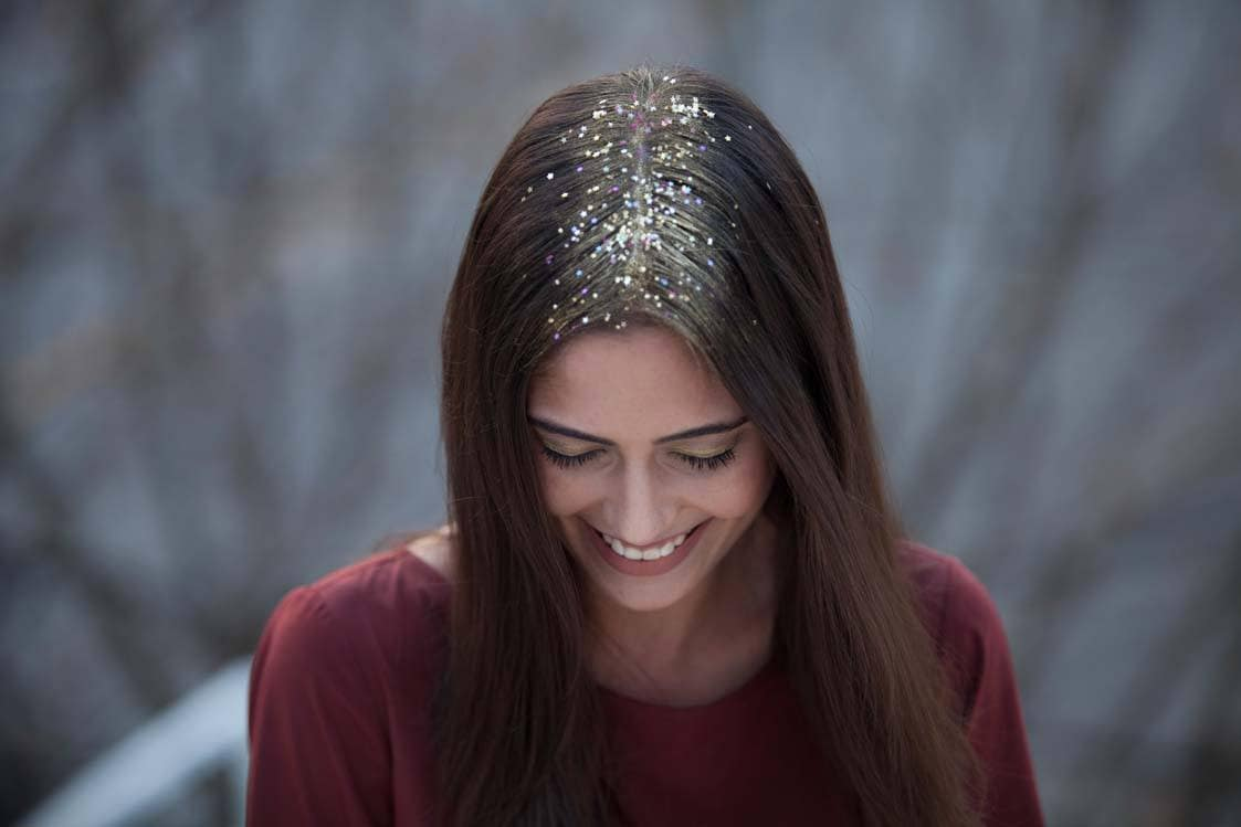 easy concert hairstyles close up glitter roots brunette