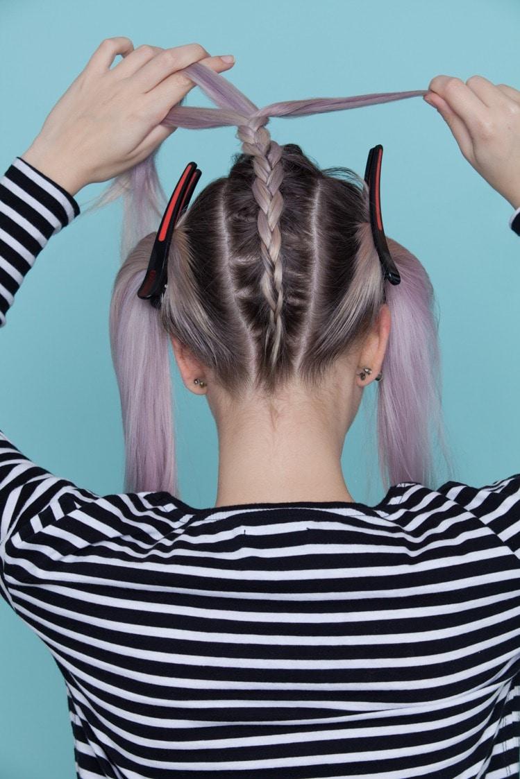 Begin braiding hair