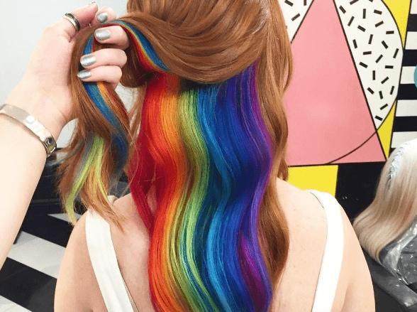 the cool hidden rainbow hair color trend
