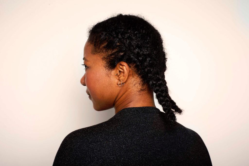 rear view of a black woman with braided hair