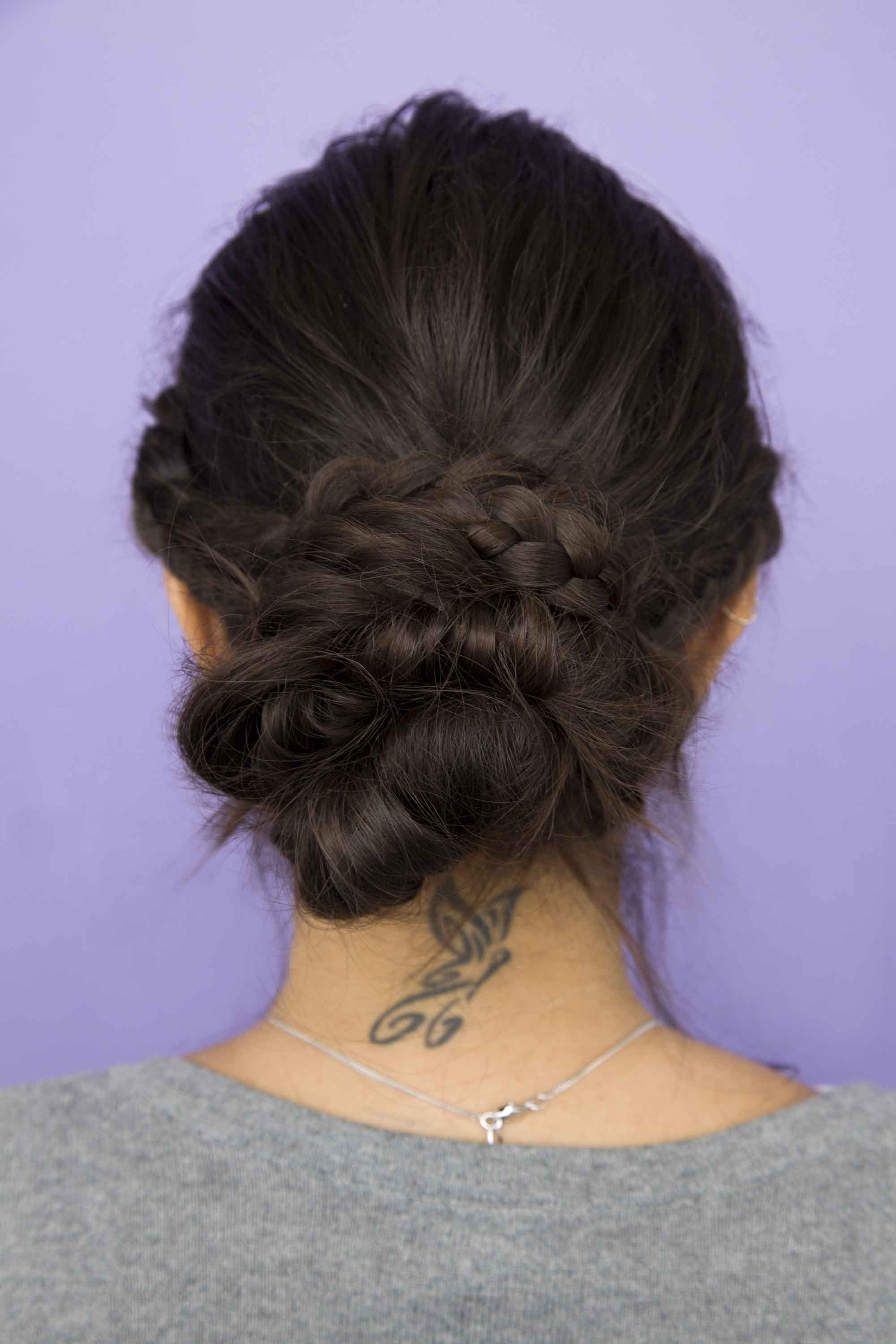a picture of braided bun brunette hairstyle of a woman
