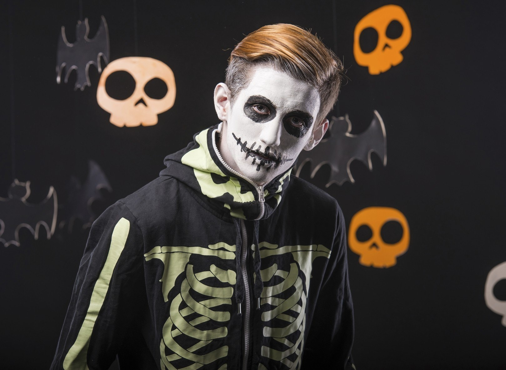 young boy wearing zombie halloween costume with combover hairstyle
