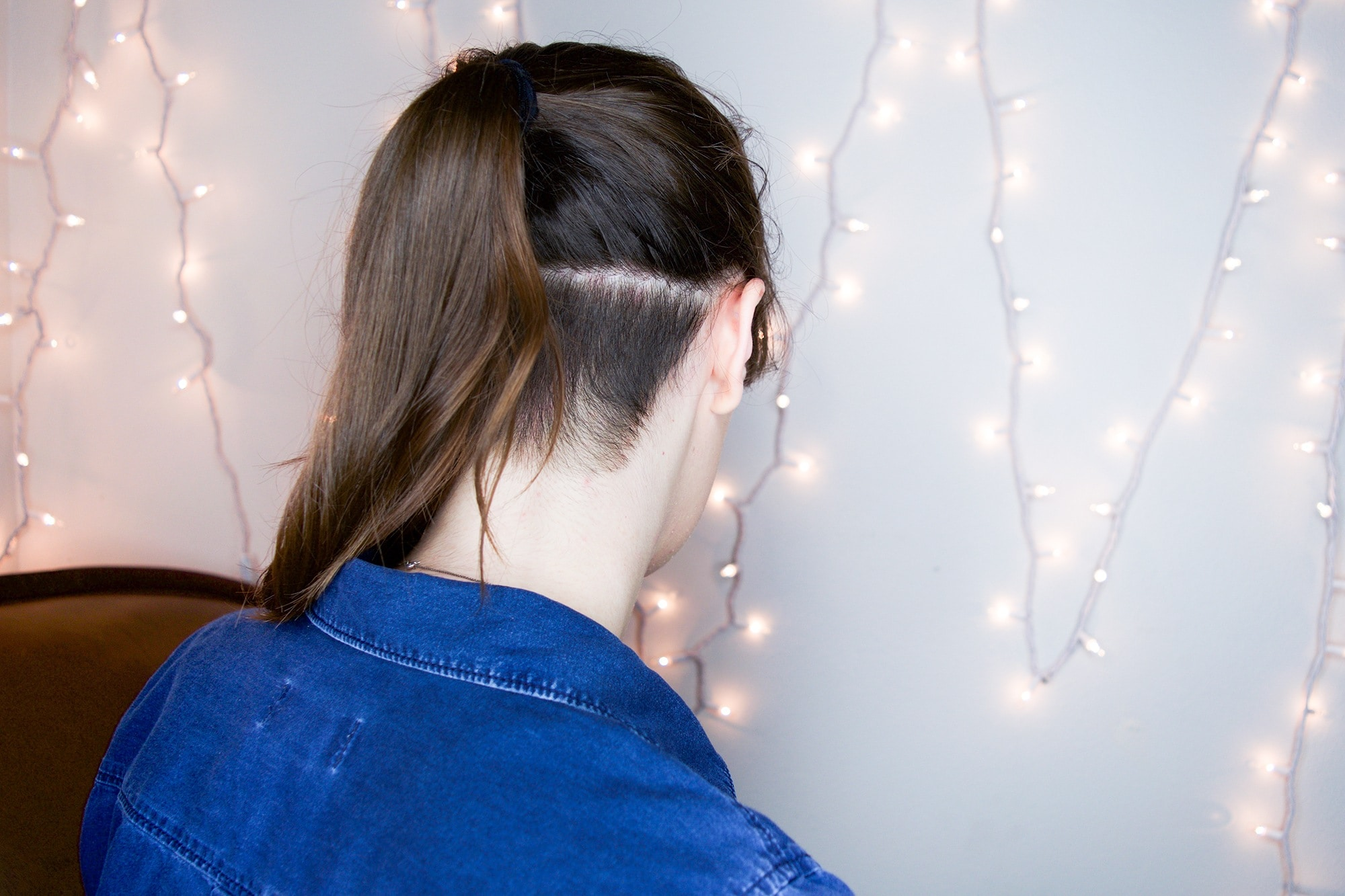 undercut with long hair and ponytail