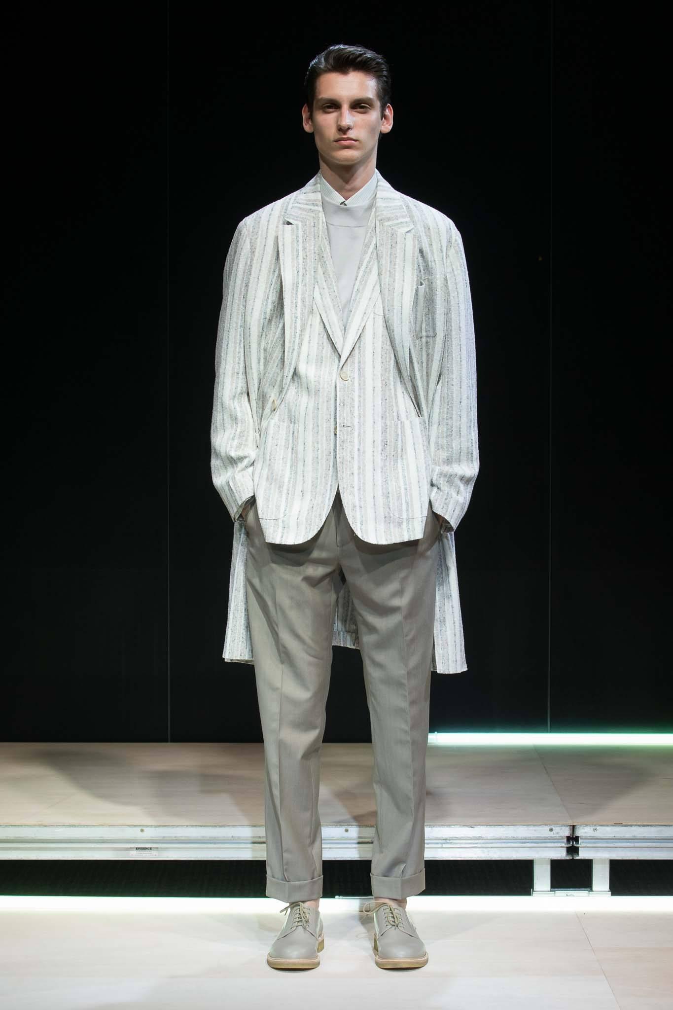 best hair gel for men: model with slicked back voluminous hair