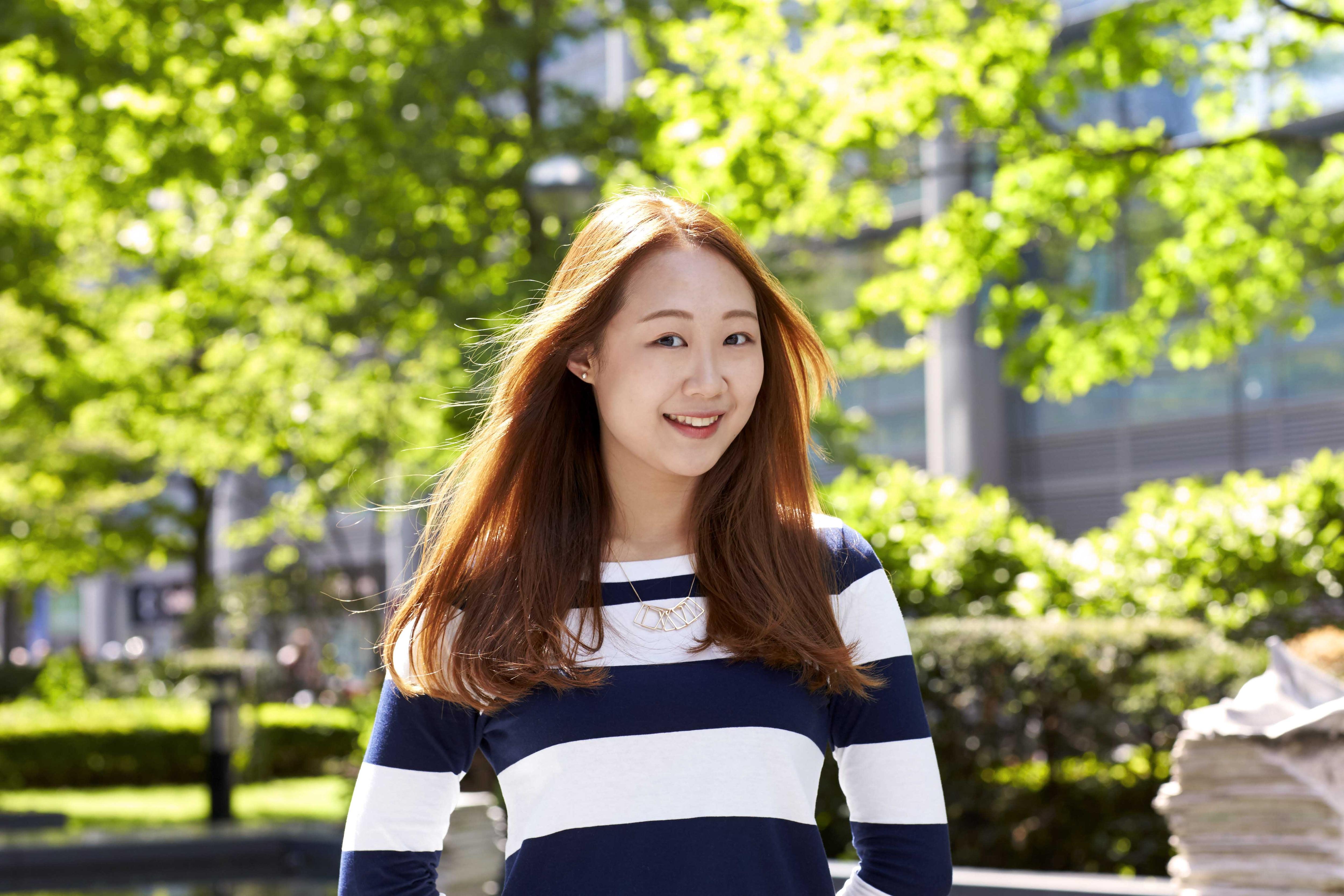 asian woman long straight copper hair