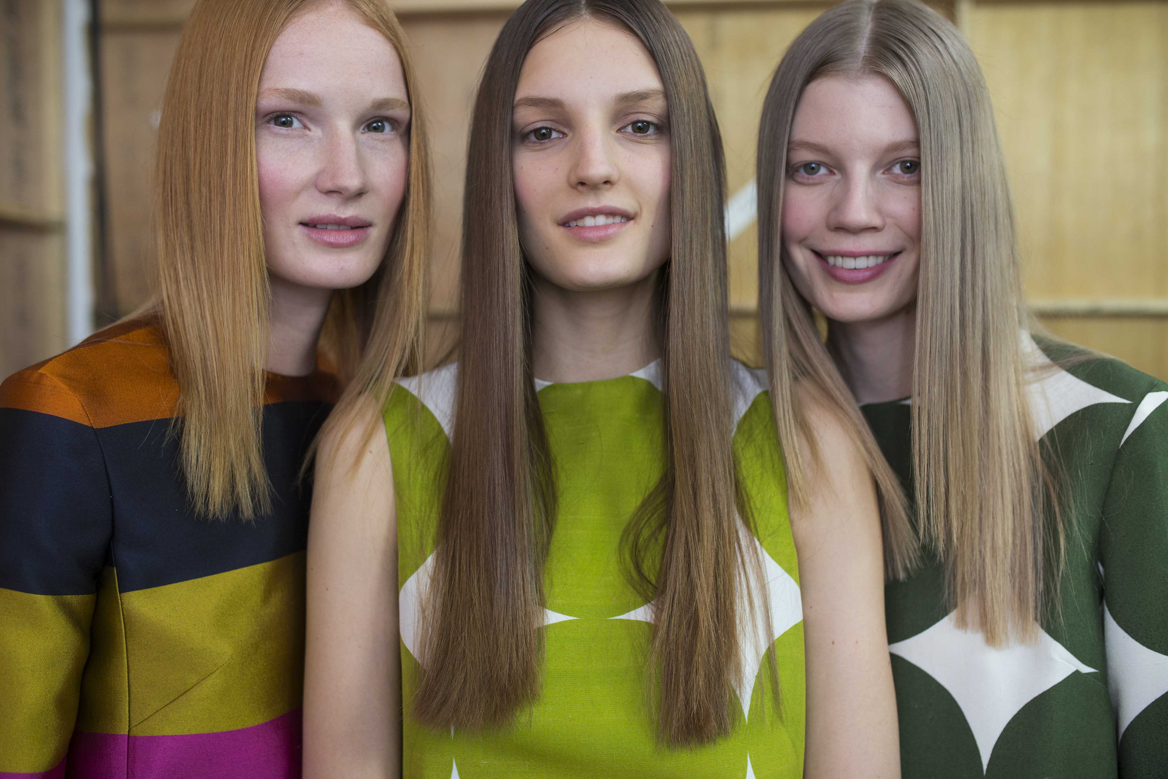 three women with long bone straight hair