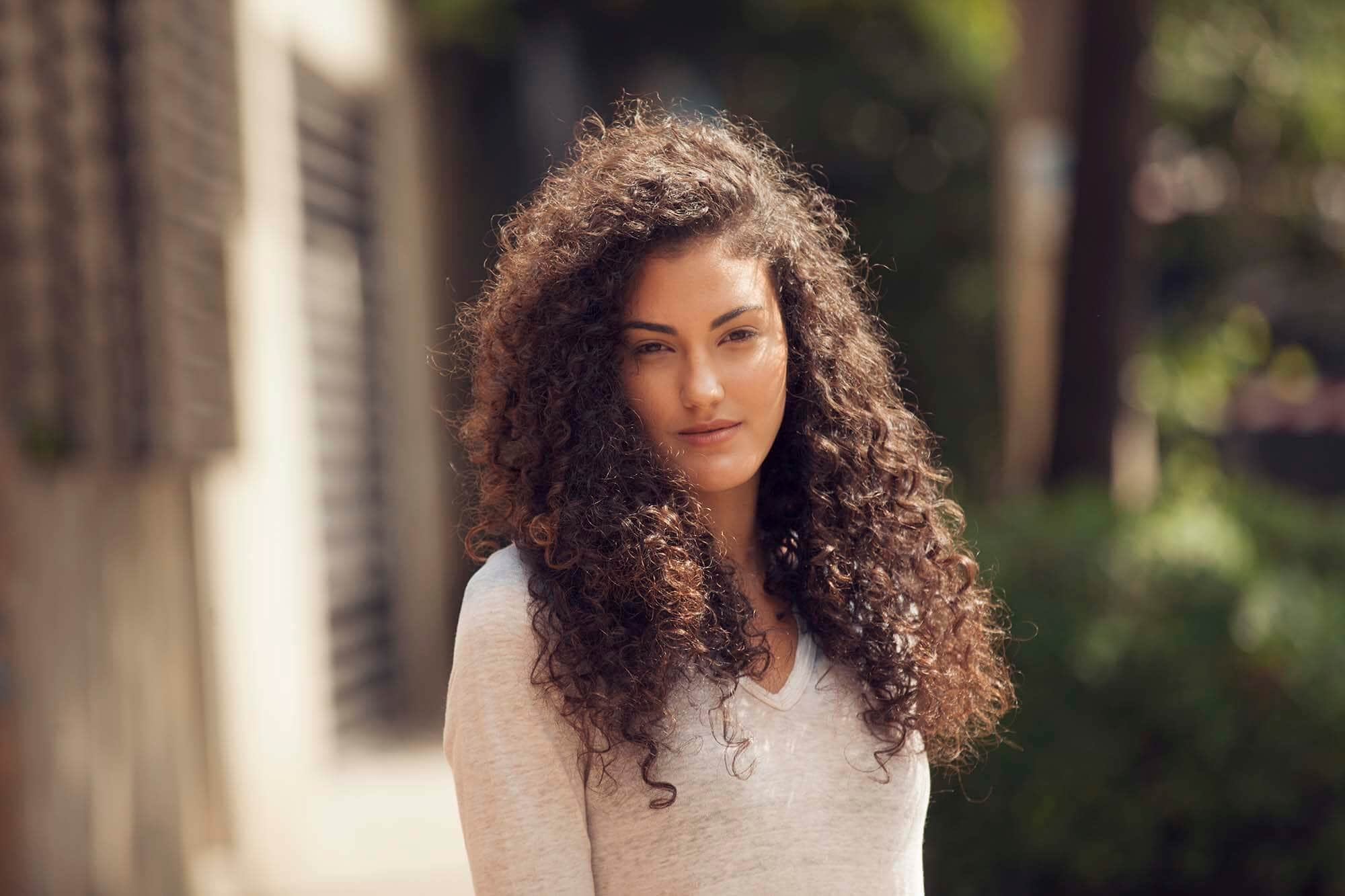 16 Easy And Modern Hairstyles For Thick Curly Hair