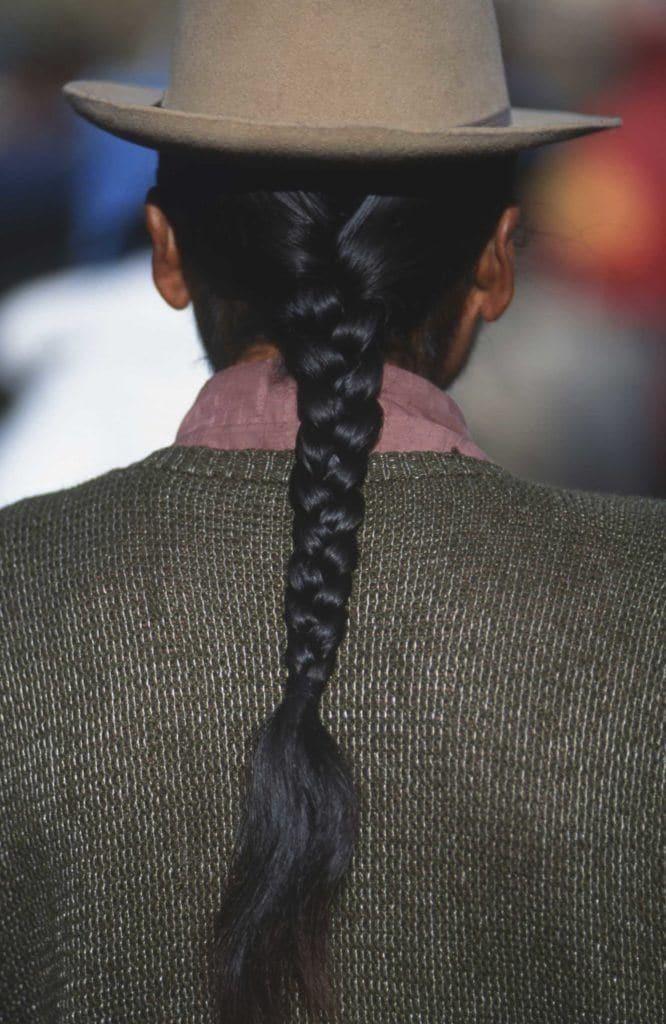 Long haired men wearing braid