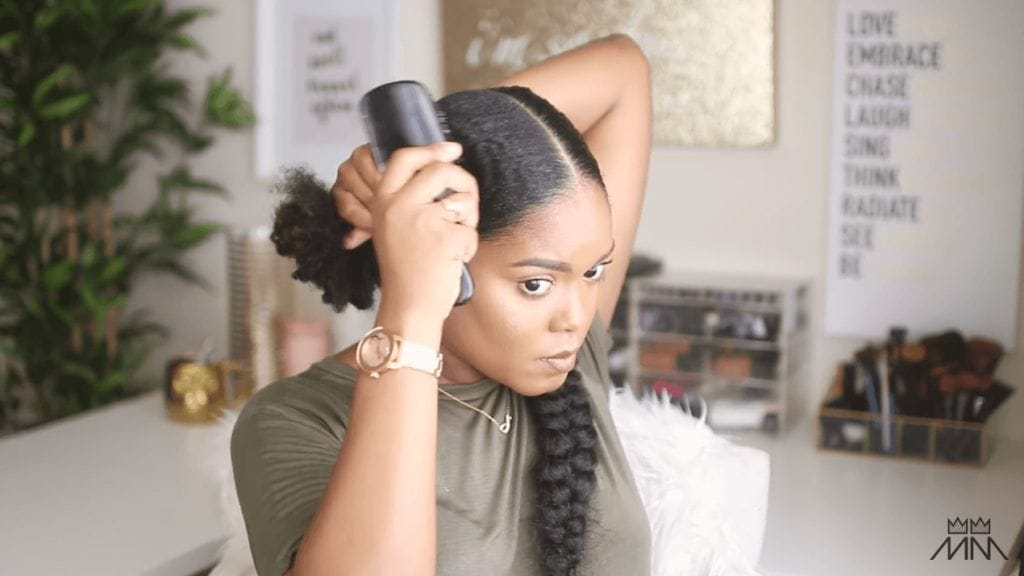mini marley brushes gel through her braided hairstyle