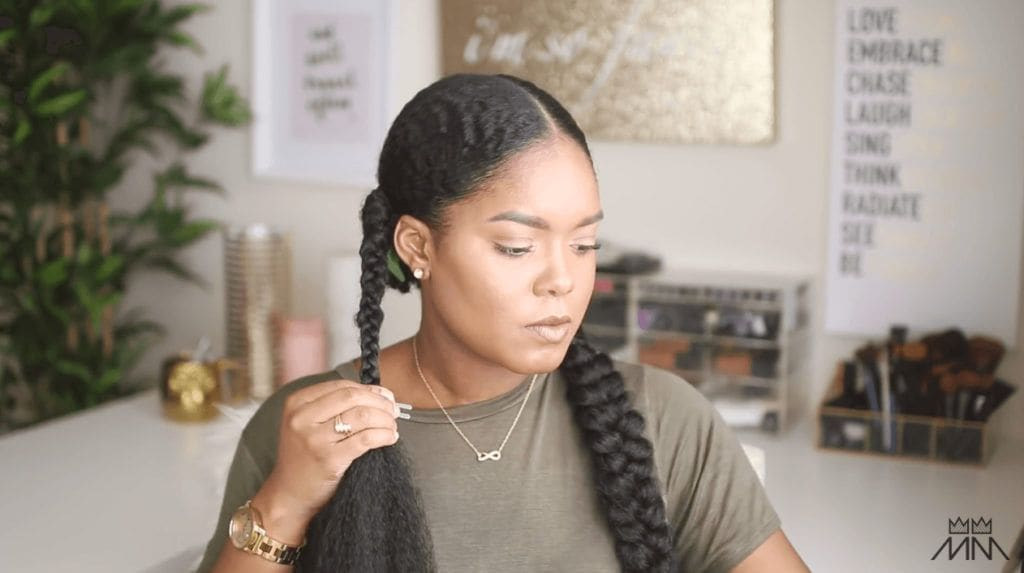 mini marley creates a braided hairstyle midway