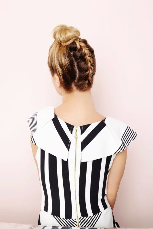 woman with braided topknot hairstyle