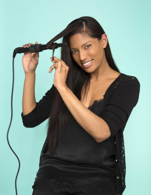 curl hair around an iron to create cascading waves