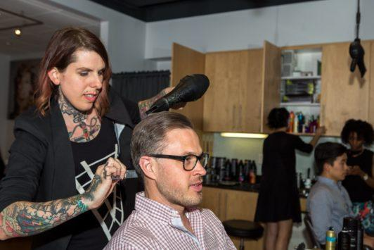 man getting hair blowdried to create combover hairstyle