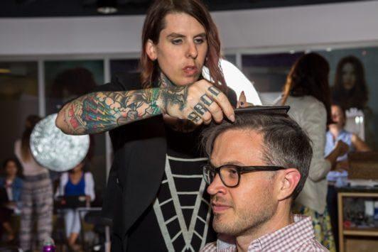 man getting hair styled at salon