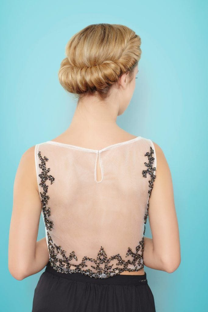 blonde woman wearing croissant bun hairstyle
