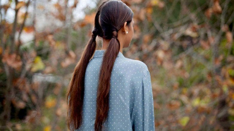 young girl wearing double ponytail hairstyle