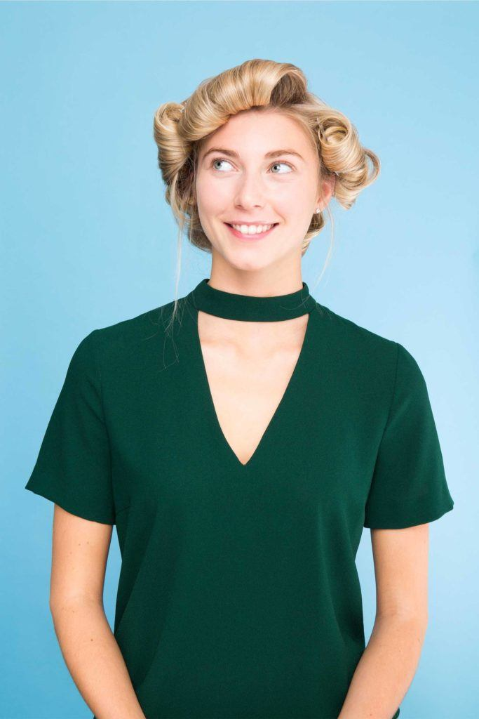 blonde woman with pin curls in her hair