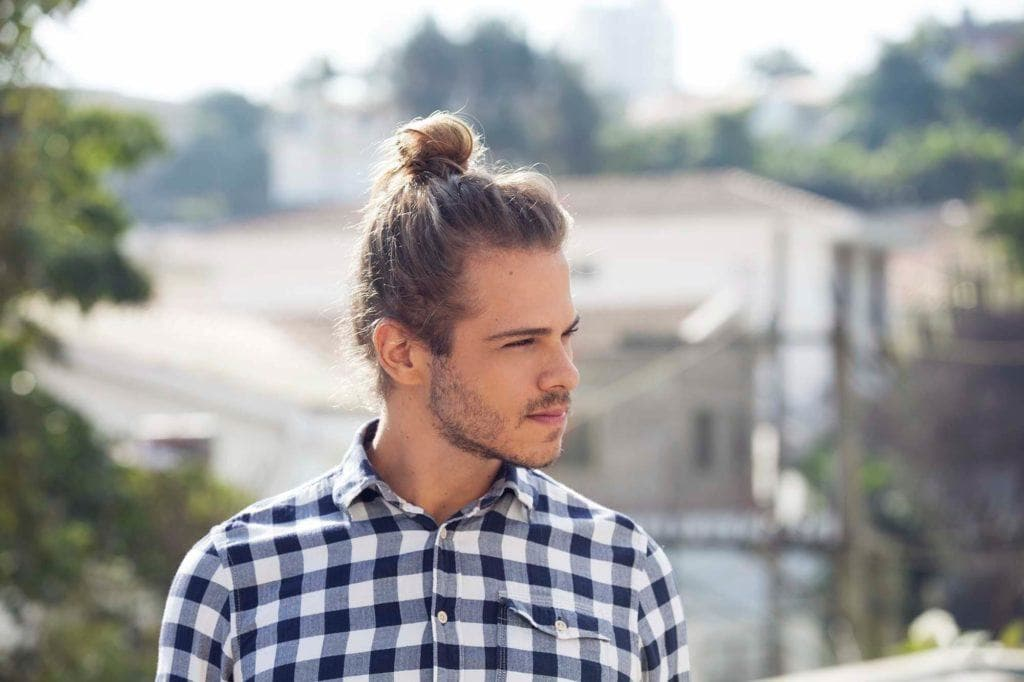 man with top knot