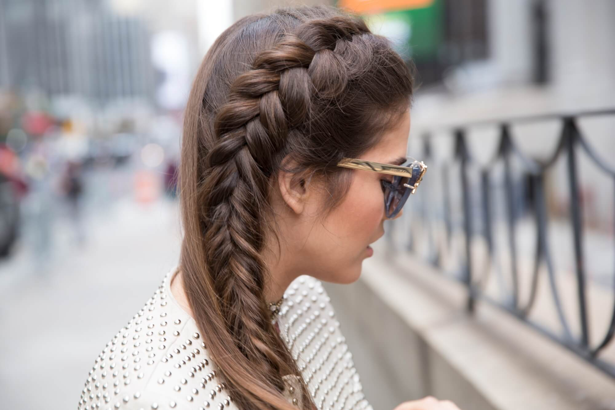 blogger Paola Alberdi from Blank Itinerary posing with mermaid braid hairstyle