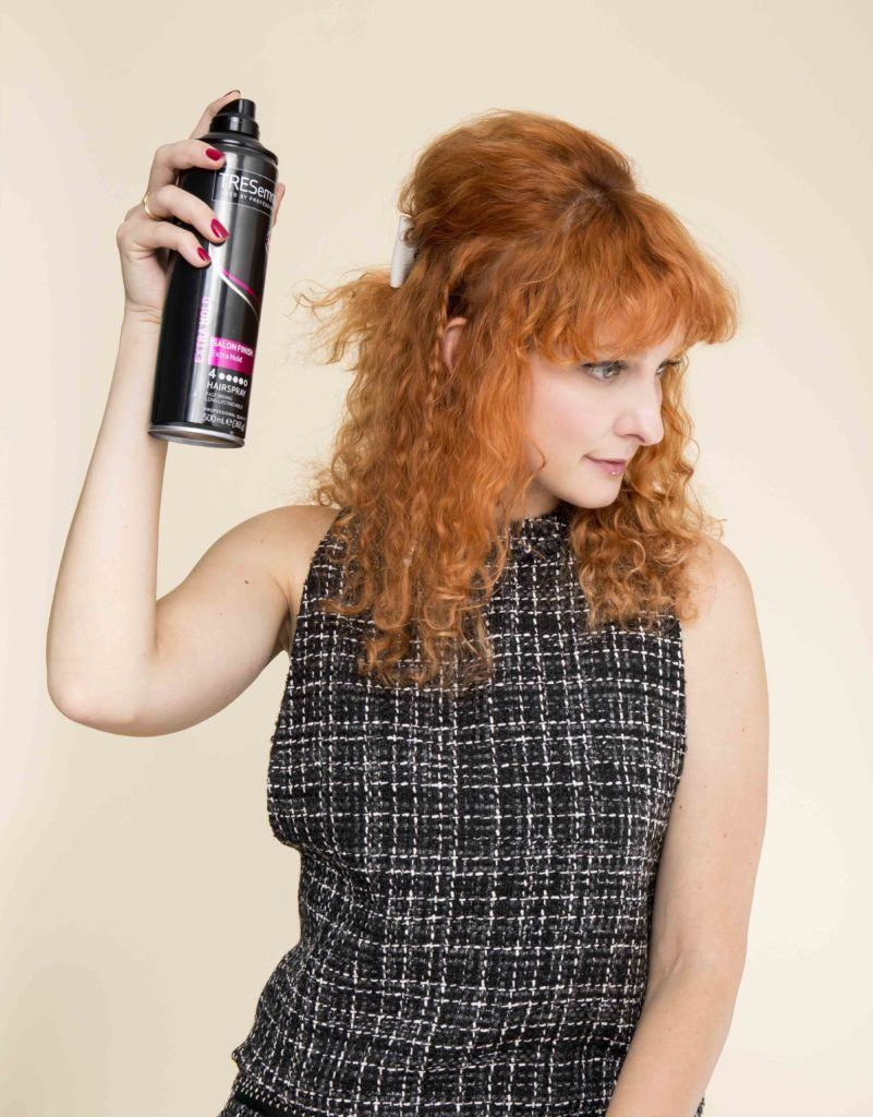 finish the bouffant hair tutorial with hairspray