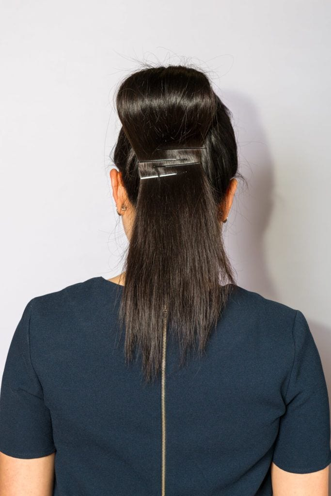 pomp ponytail back with pins