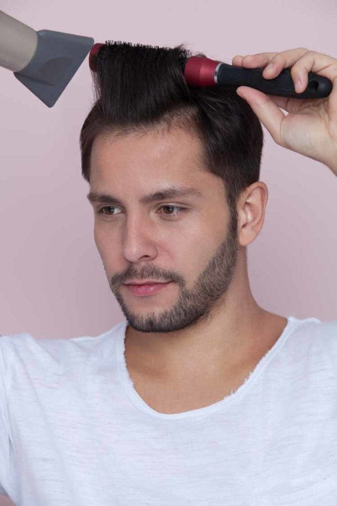create the pompadour hairstyle by blowdrying your hair