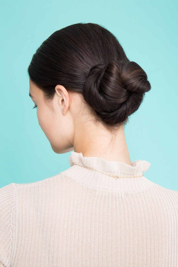 woman with pretzel bun hairstyle