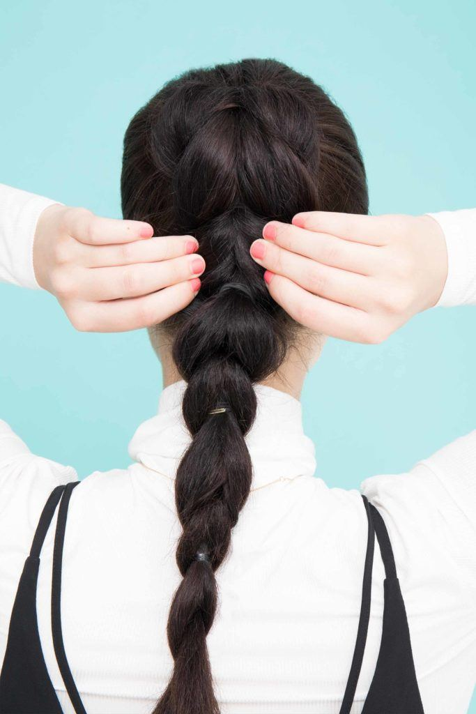 young lady with long black hair pancaking ponytail