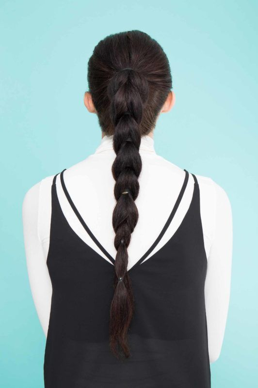 young lady with long black hair pull through ponytail