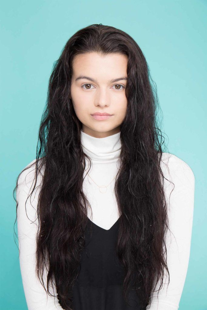 young lady with long black wet hair