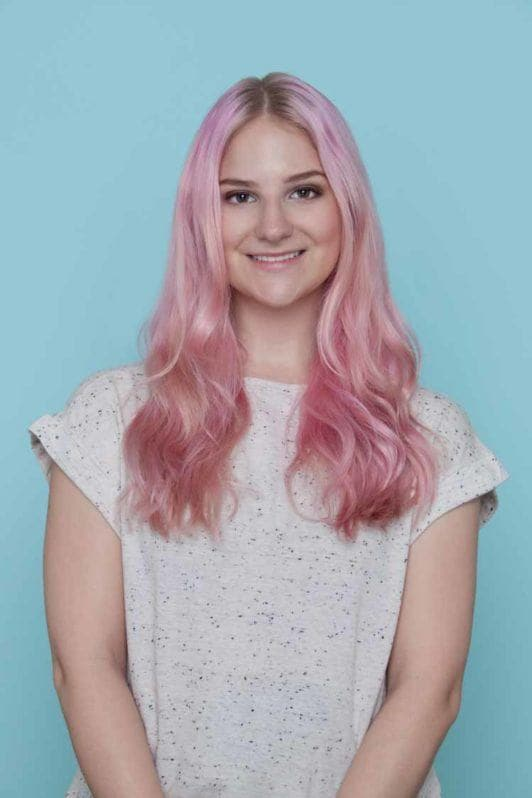 young woman with long wavy pink hair