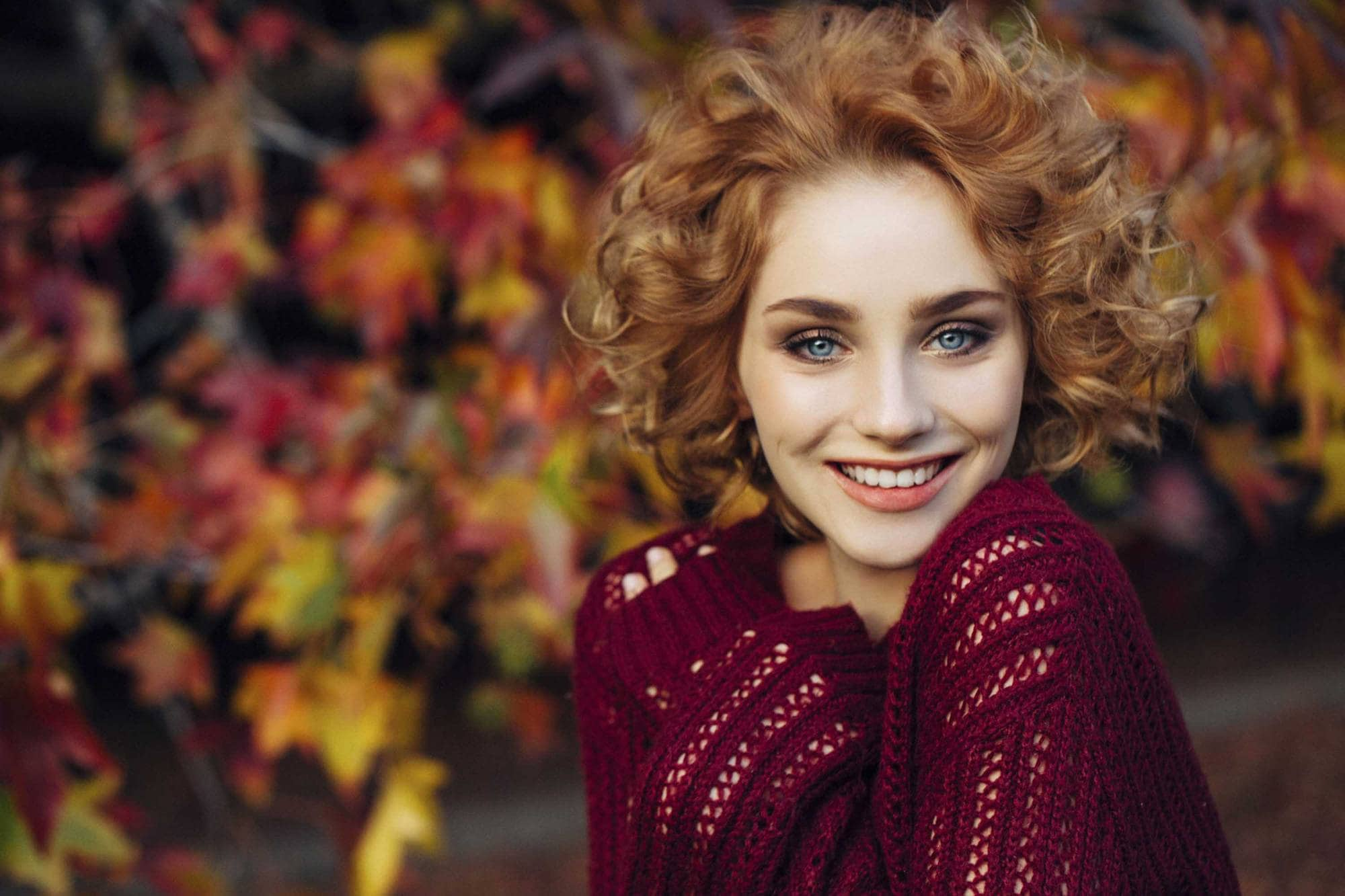 redhead woman with curly hair bob no part