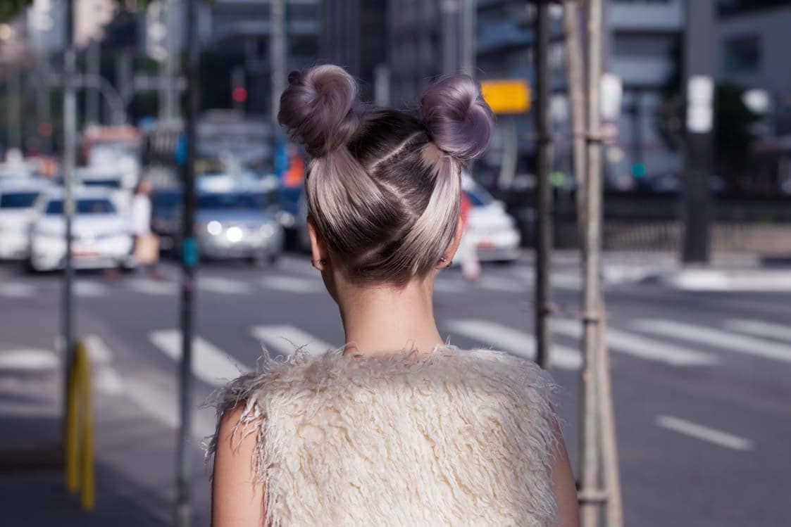 create winter ball hairstyles with chic space buns
