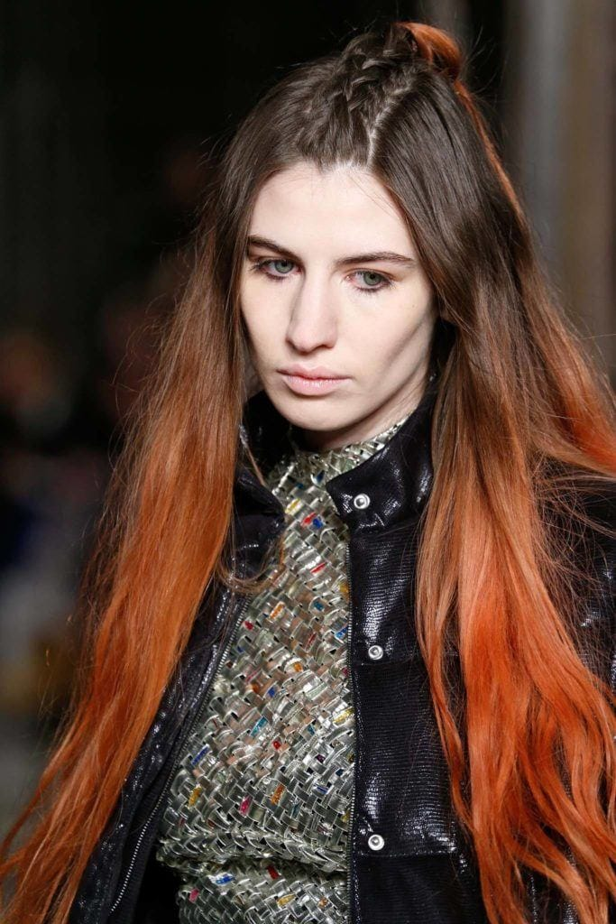 Beautiful women with ombre blood orange hair