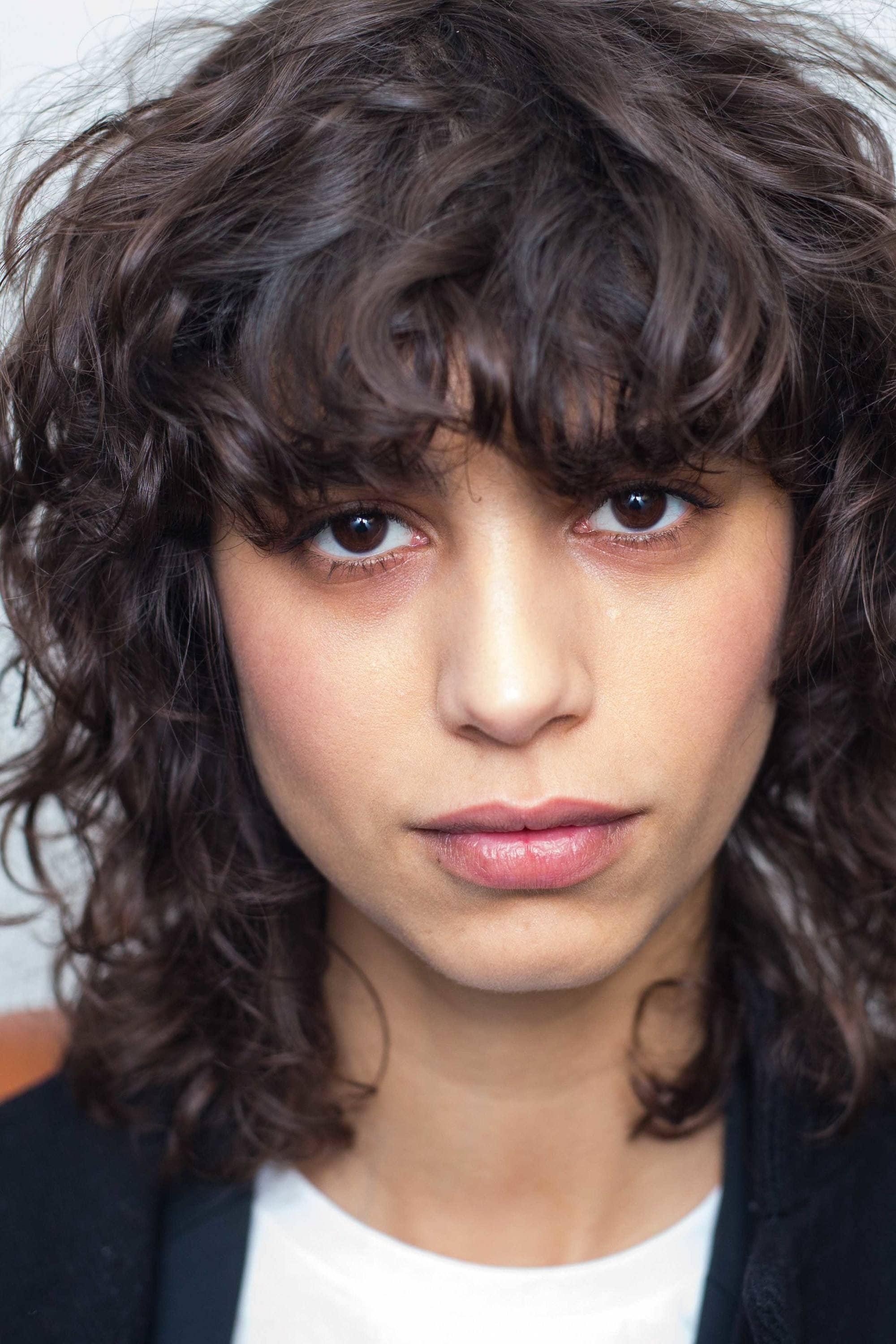 Curly Shag Bangs are one of the more natural fresh bang hairstyles