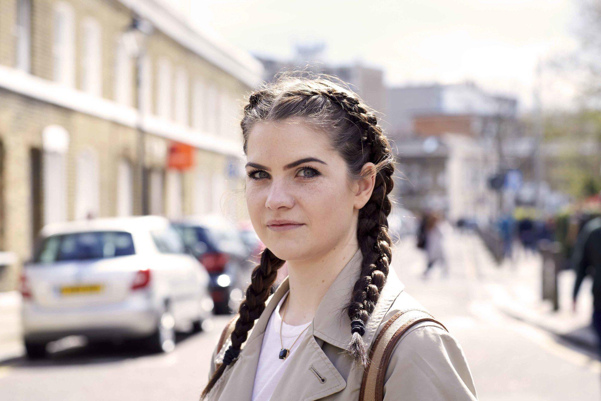 young woman wearing Dutch braids on long hair