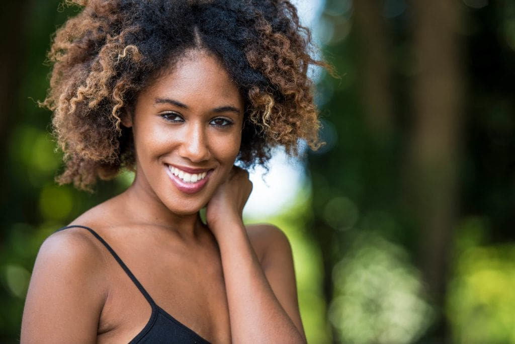 Beautiful woman with a blonde afro