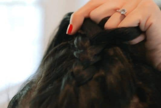 nikki phillippi creating braid on middle section of hair
