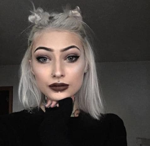trendy space buns on white hair